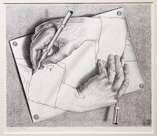 """Maurits Cornelis Escher, """"Drawing Hands,"""" 1948. (Robin Lubbock/WBUR)"""